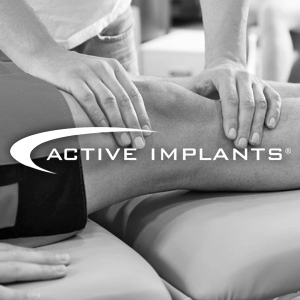 Active Implants logo over a photo of a doctor and patient