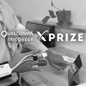 Qualcomm Tricorder XPRIZE logo over a photo of a hand wearing a medical device